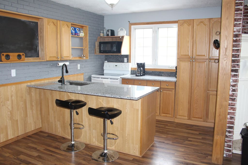 full kitchen, with coffee maker, electric kettle and bluetooth speaker