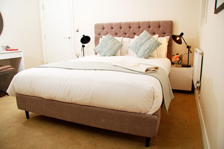 Deluxe bedroom with hotel quality linen