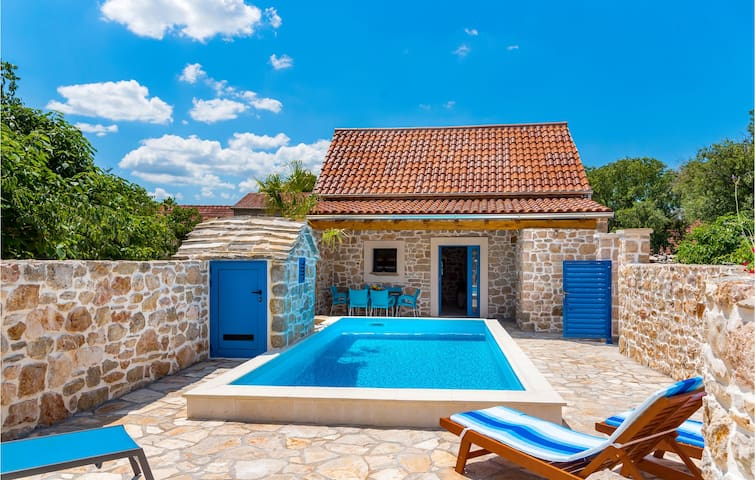 Stunning home in Drnis with Outdoor swimming pool, Outdoor swimming pool and 1 Bedrooms