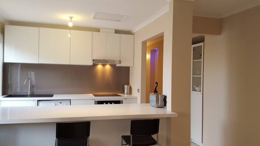 Brand new European style kitchen with European appliances, fully equipped (cook top, oven, microwave, toaster, kettle, fridge, crockery)