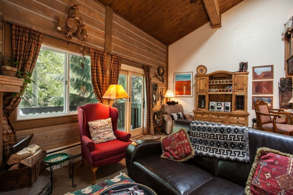 Cozy living area with inviting rustic mountain decor. Common outdoor deck faces south toward the Gore Creek.