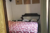 """Main bedroom with king size bed """"fen shui"""" oriented north / south"""