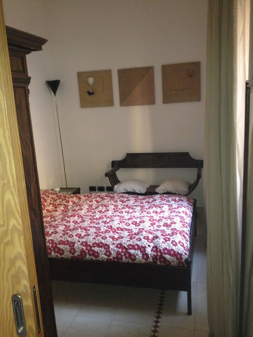 "Main bedroom with king size bed ""fen shui"" oriented north / south"