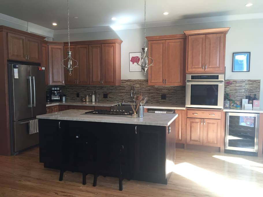 Large, open kitchen with brand new appliances throughout