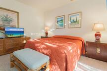 Relax in your spacious ensuite bedroom with AC & private lanai overlooking garden
