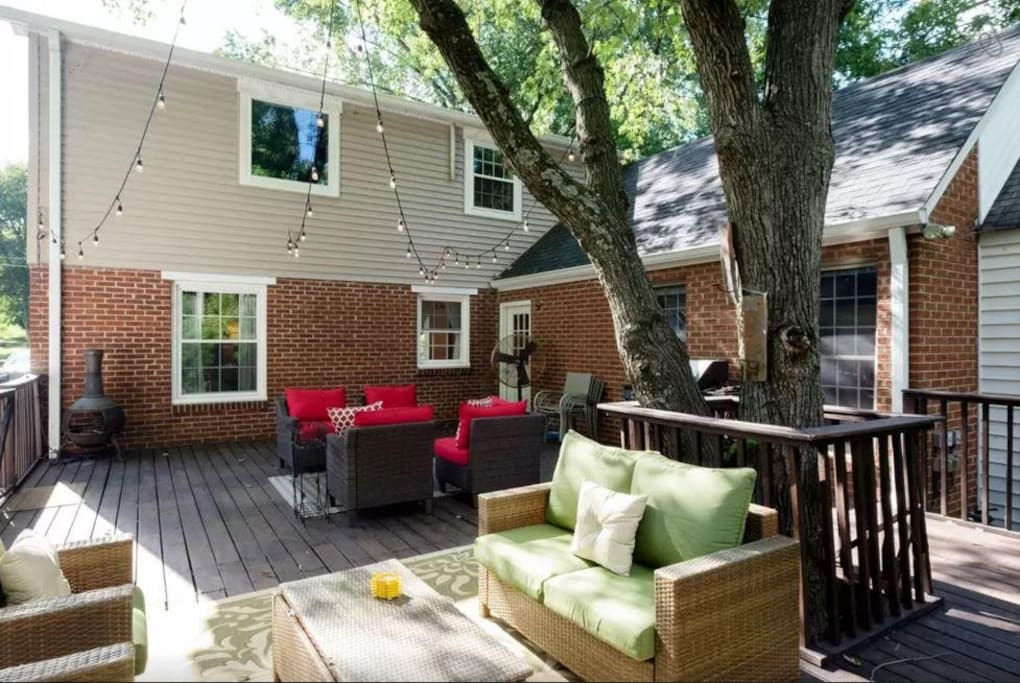 A huge back deck with seating and grill