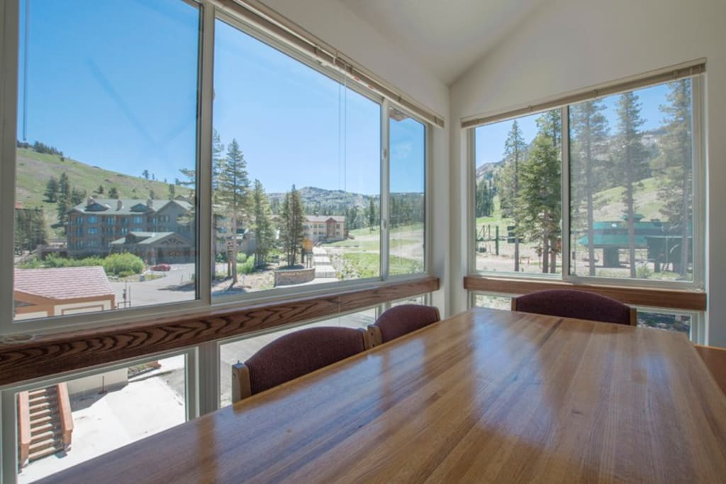Summer View of lifts from large floor to ceiling windows