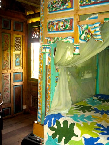 In the traditions of Madura, an ornately carved and painted bed for two.