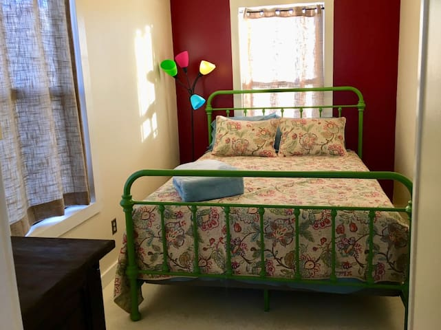 One Bedroom with Queen Bed, Small closet and Chest of Drawers.