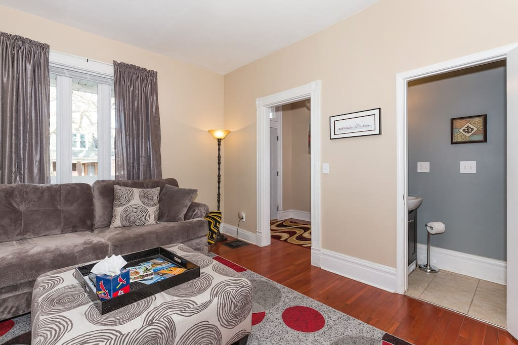 This bright and stylish room has a half bath so you don't have to miss your entertainment.