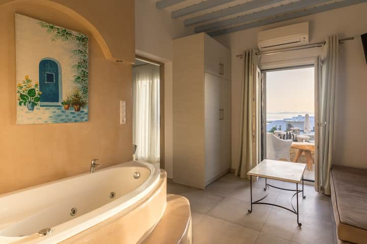 Suite with Sea View indoor jacuzzi bath. Mykonos.