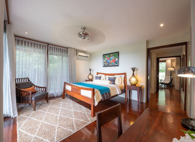 Bedroom 4: King-sized bed with writing desk, sea views and wrap around balcony.
