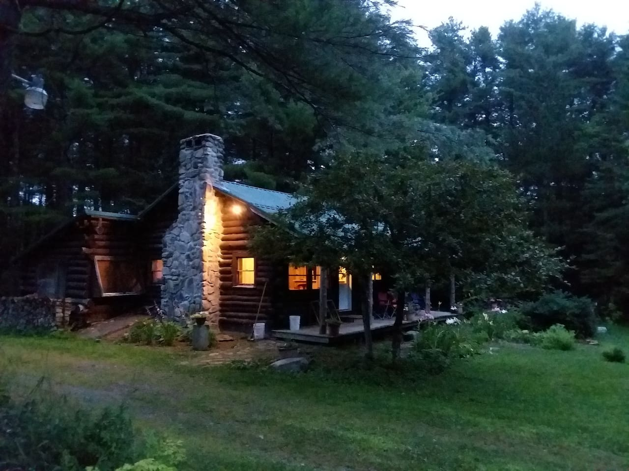 Log cabin at Stonecrop Meadow with two private guest rooms and host loft.