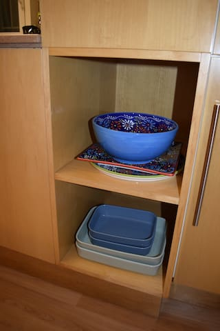 Serving dishes in open shelving in the diningroom