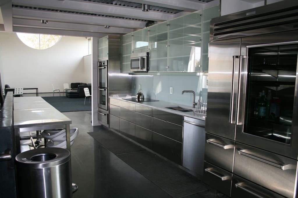 Stainless Steel Kitchen with SubZero Fridge/Freezer, Induction Stove