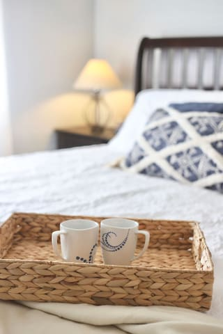 Enjoy coffee in the master bedroom's king-sized bed. You can actually see a slice of the ocean from the master bedroom window. Enjoy that beautiful sunrise!