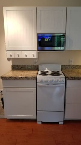 Kitchen , Stove, Microwave, Fridge,  Coffee Maker, Toaster.