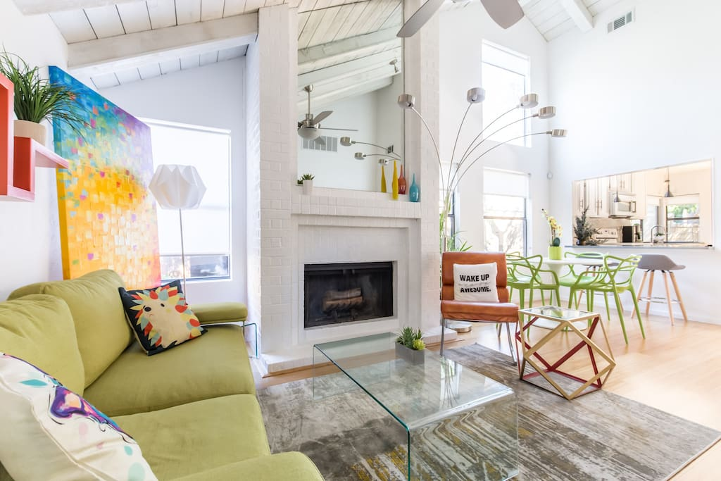 Artsy Living room with high vault ceilings through out the home.
