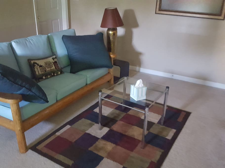 """Living Room, comfortable seating.  Roomy with new 48"""" Smart TV."""
