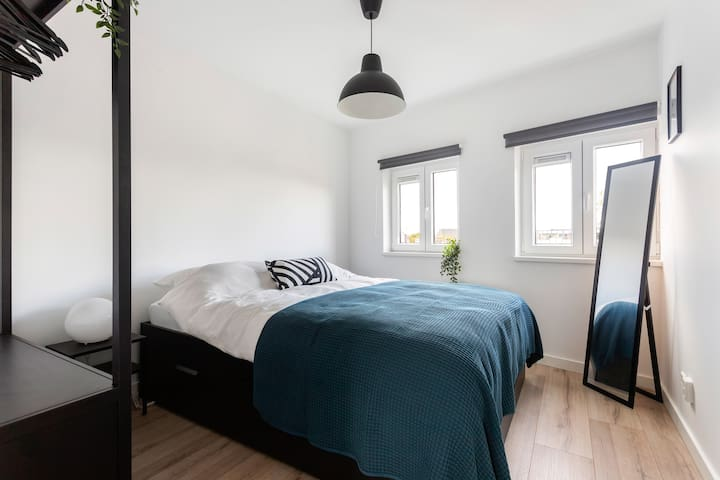 A modern bright room in a spacious apartment.