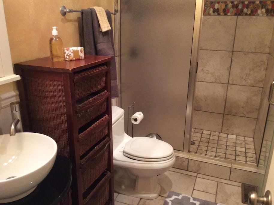 The bathroom is fitted with a spacious shower.
