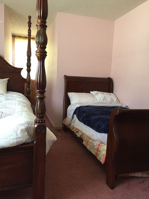 A king size bed and a twin sleigh bed