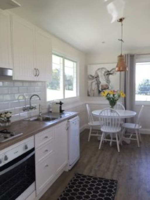 Country Kitchen with all new appliances including oven, gas cooktop, dishwasher & Nespresso machine