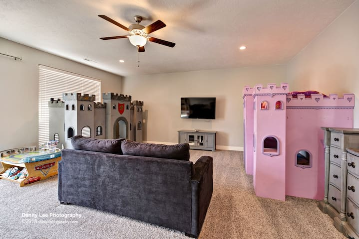 The ultimate kid's loft features both a boy and girl castle, Wii gaming system, sofa sleeper, Cars race track, Barbie house, game table & foosball table.