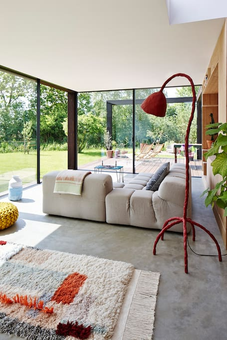 spacious living room with modern design surrounded by glass sliding doors