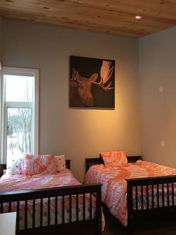Bedroom #3 with 2 doubles, 2 corner windows