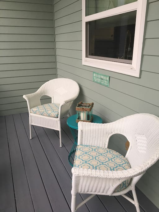 The front porch at Mermaid Cove is perfect for enjoying a good book or cup of coffee
