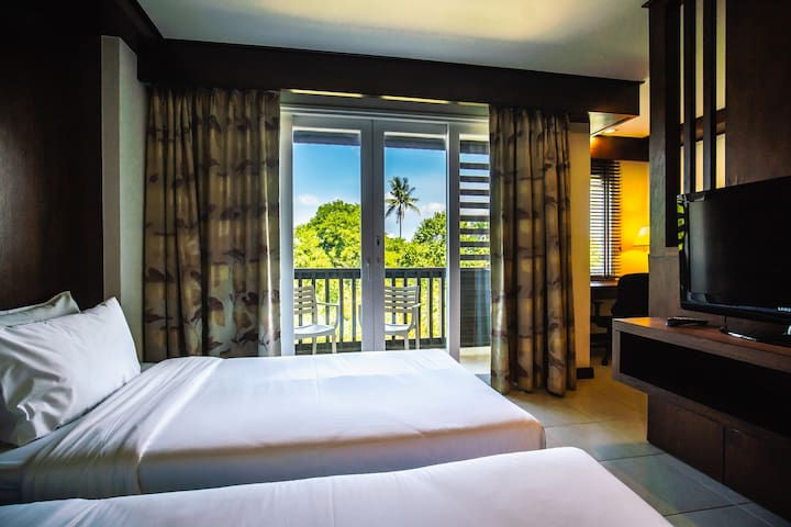 Boost your energy level by staying peacefully among the tropical trees, breeze and nature.