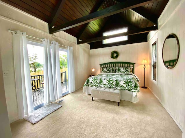 Main Bedroom has a comfortable king size bed. There are sliding doors off to a deck with a bistro for you to enjoy your morning coffee.