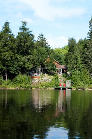 Large waterfront log house with new exterior spa