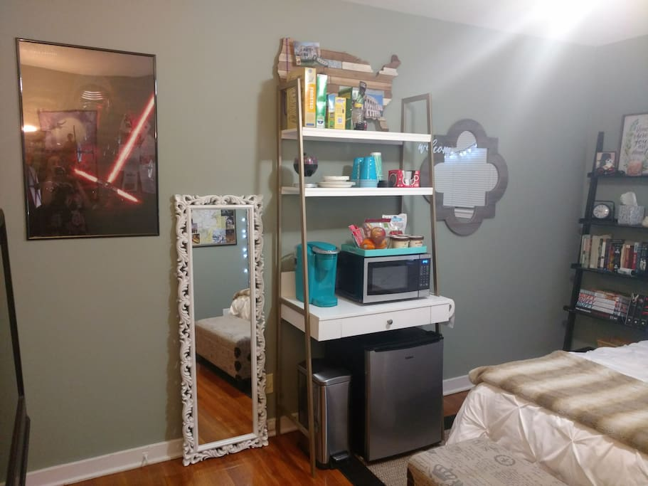 Full length mirror, kitchen area with fridge, garbage can, microwave, coffee pot, breakfast foods. And Kylo Ren to keep you company.