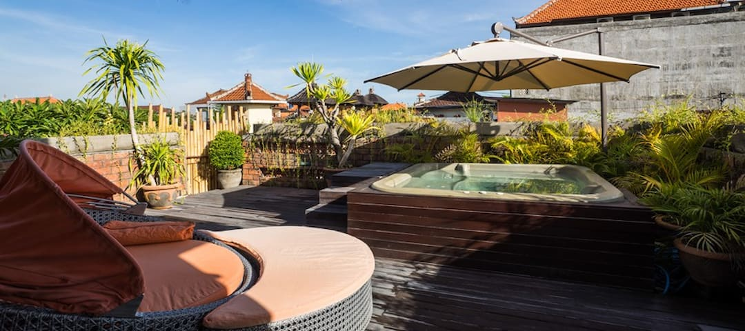 Cozy house roof terrace and jacuzzi