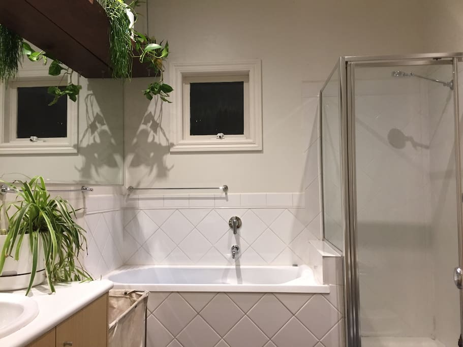 Bathroom with greenery- bath and shower