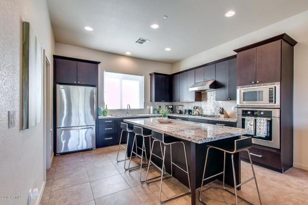 Updated Full Kitchen with Cookware and Large dining island.