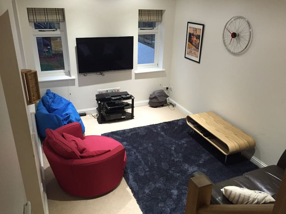 Spacious Living room with surround sound tv, comfy sofas and fluffy rug