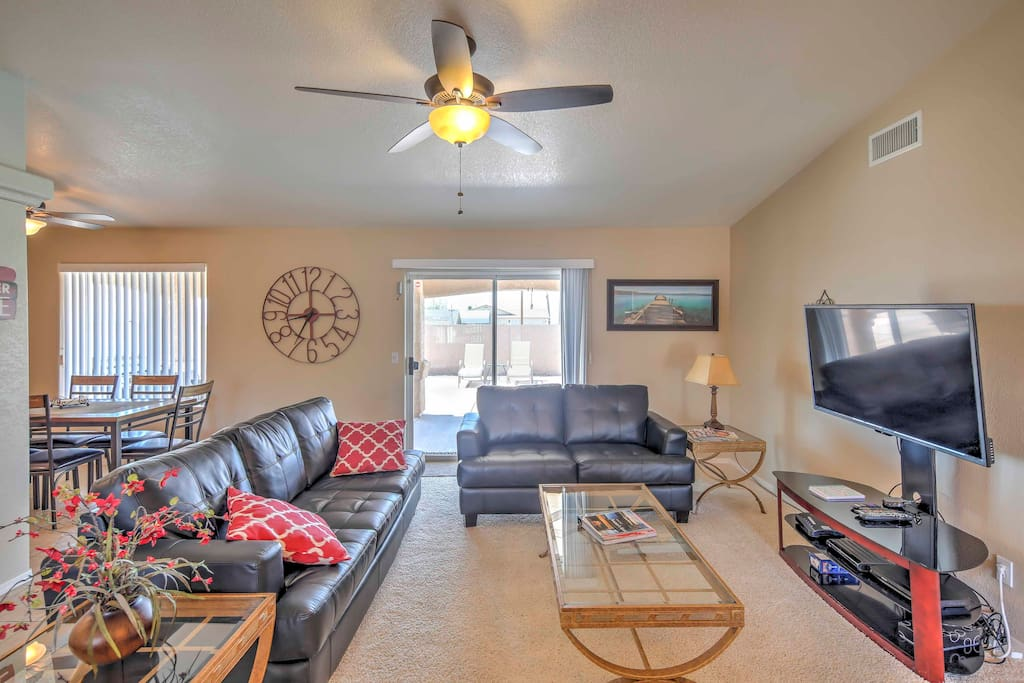 The spacious living area includes comfortable leather sofas,  and a 50-inch flat-screen cable TV.