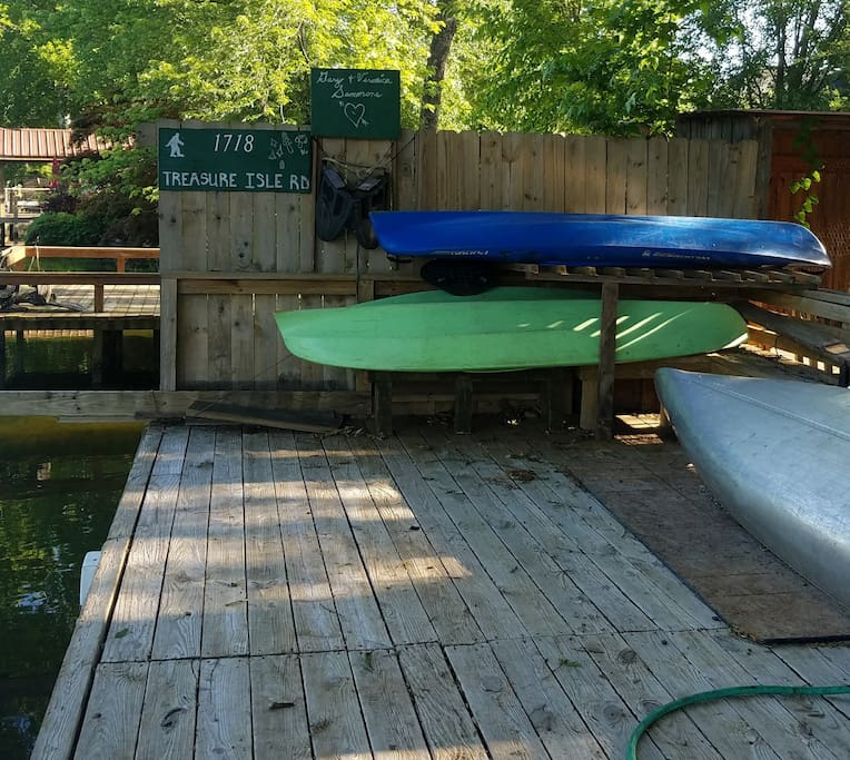 dock, kayaks and canoe for boating.