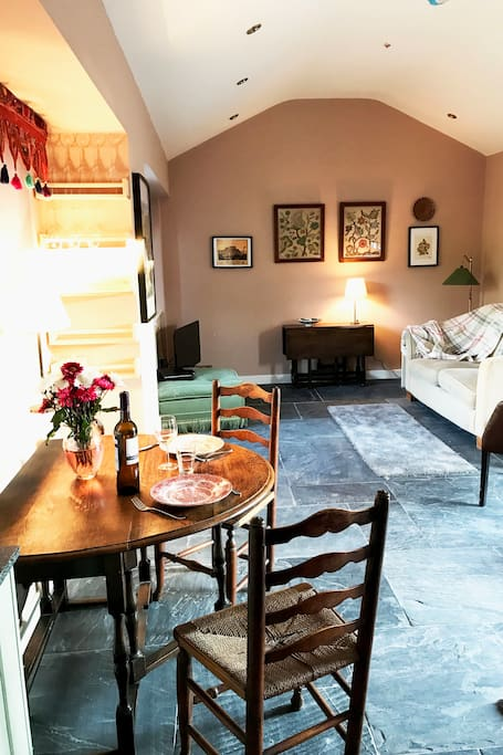 The living area of St Drogo's - open plan and light filled, characterful mix of antique and modern - designed for living.