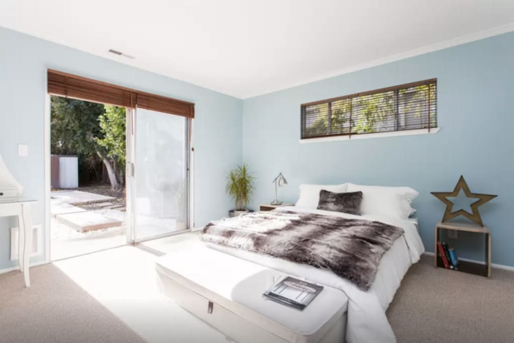 Master bedroom with private access to back yard