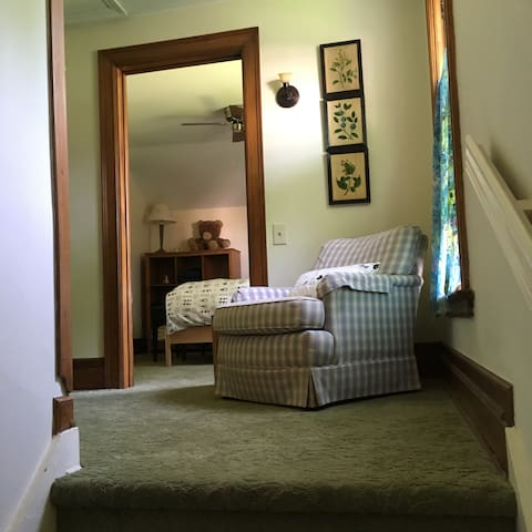 Climb the back stairs to your private bed and bath.