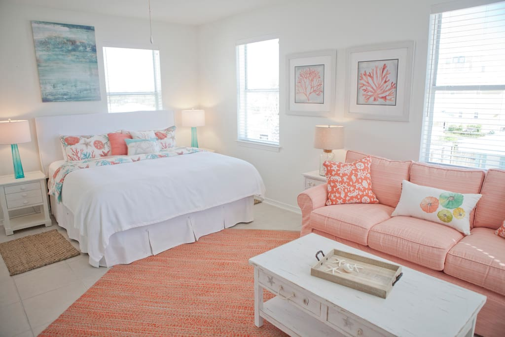 Upstairs King Guest Bedroom features it's own bath, sitting area with Queen sleeper sofa and large HD TV
