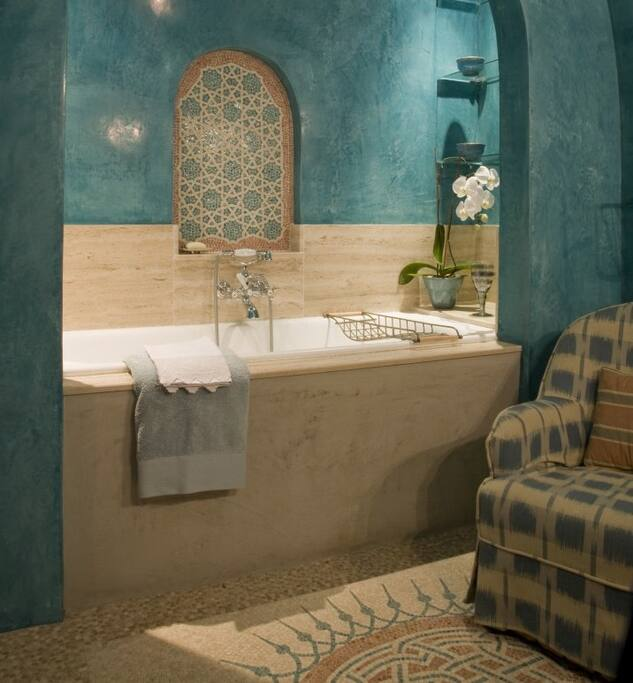 Master en-suite bathroom with Polished plaster walls and hand-made mosaics.