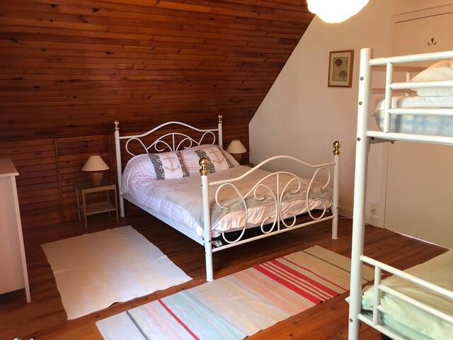 Bedroom with double bed and bunkbeds
