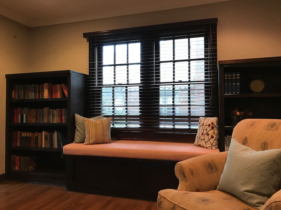 Built in cabinets with reading nook on main floor
