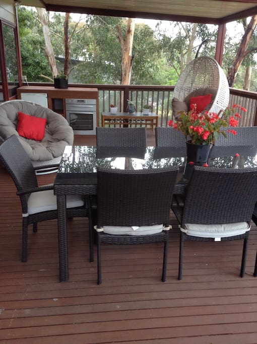 Large deck with bbq, bar fridge, outdoor oven and a great bush view