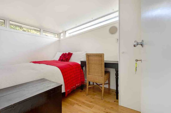 Small light filled single bedroom with ensuite